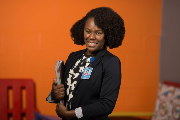 Associate Dianne Dixon posing with a notebook