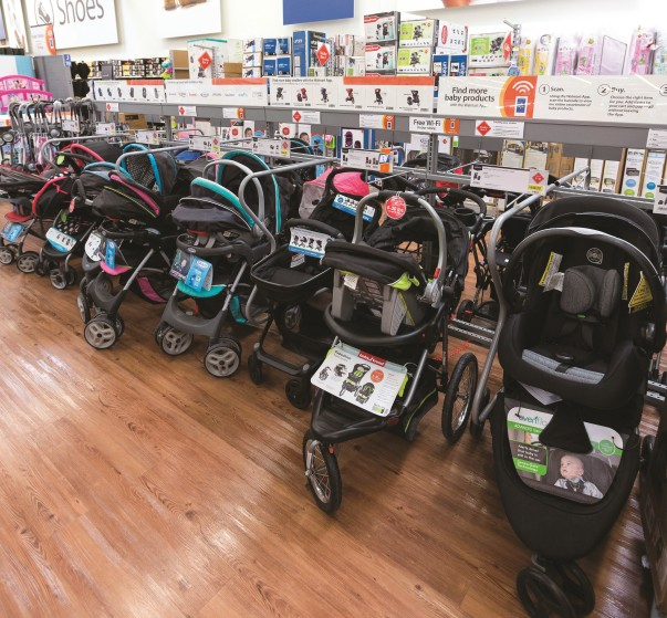 Baby strollers line the baby department floor in a Walmart Supercenter