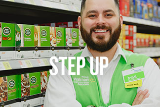 Ryan stands proudly with his arms crossed over his green Walmart vest and has a big smile. Text reads: Step Up