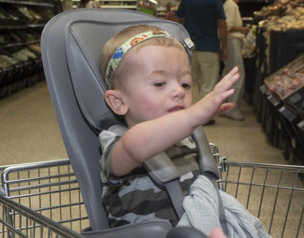 Leo waves from his trolley
