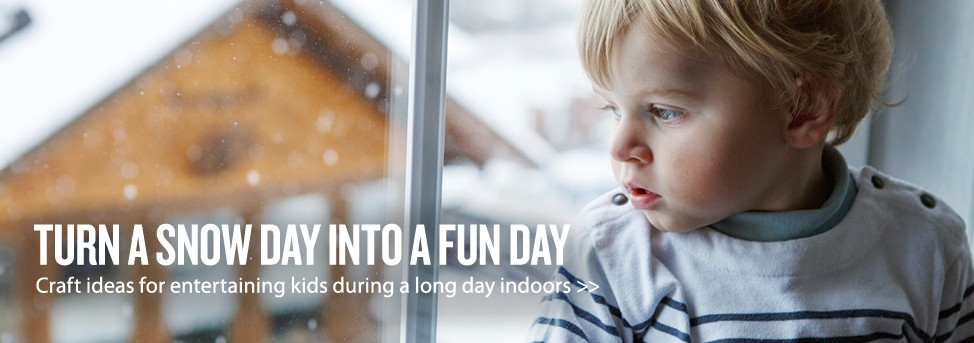 "A young boy watches the snow fall outside. Text reads ""Turn a snow day into a fun day. Craft ideas for entertaining kids during a long day indoors >>"""