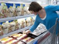 Photo of a Sam's Club member shopping for cheese