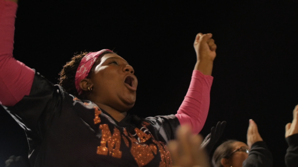 A female associate cheering at a football game