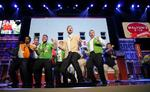 Host Justin Timberlake does a squiggly during the Walmart Cheer at Shareholders' Meeting 2012
