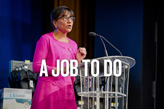 U.S. Secretary of Commerce Penny Pritzker speaks at a glass podium. Text reads: A Job to do