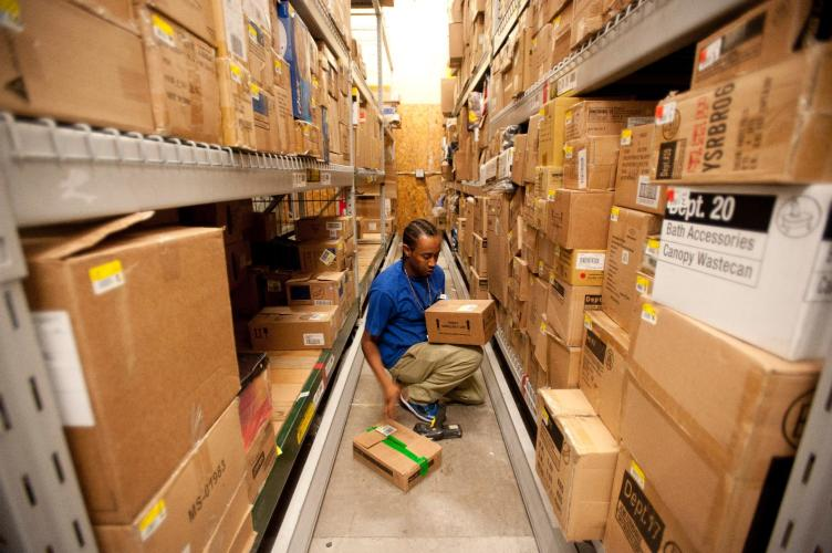 Walmart associate works in the back room of a store