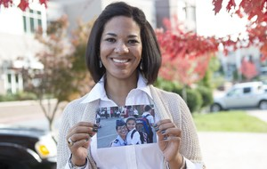 April Legere, veteran associate, holds a picture of her and her daughter