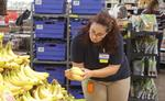 An associate selects products for Walmart To Go