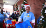 Associates with carts of gifts