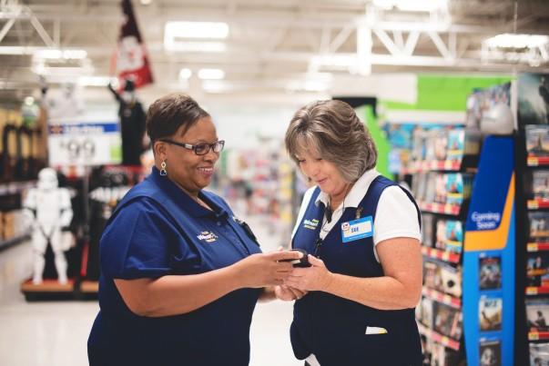 Associate Lisa Moore with coworker inside store