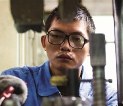 A man is working in a factory