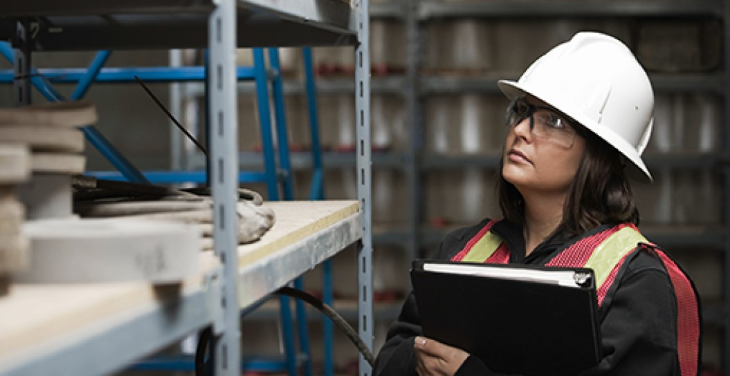Female Worker in Warehouse With Hard Hat