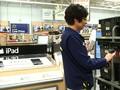 Walmart e-commerce fulfillment worker scanning bin for ship from store order
