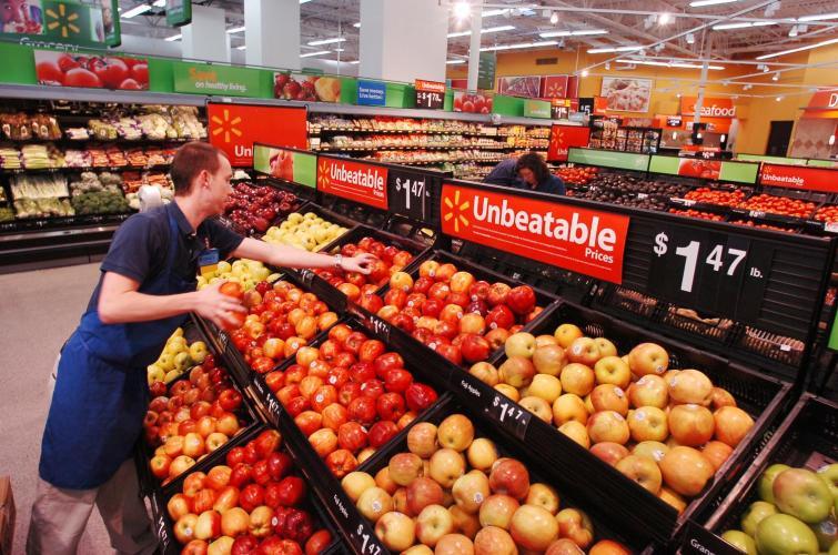 Walmart associate stocks produce