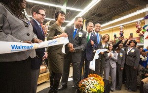 Mayor cuts ribbon on stage with Walmart Associates
