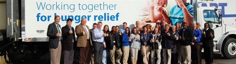 media-images-other-hunger-reliefgroup-in-front-of-truck_129828651600935728_751x205.jpg