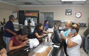 Busy day! The Sam's Club team helps owner Doris and the El Faro team serve lunch