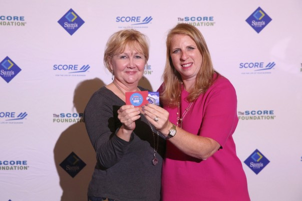 Spindaroos Founder Michele Lucas and Vice President of Development for the SCORE Foundation, Resa Kierstein celebrate their $1,000 Sam's Club gift card