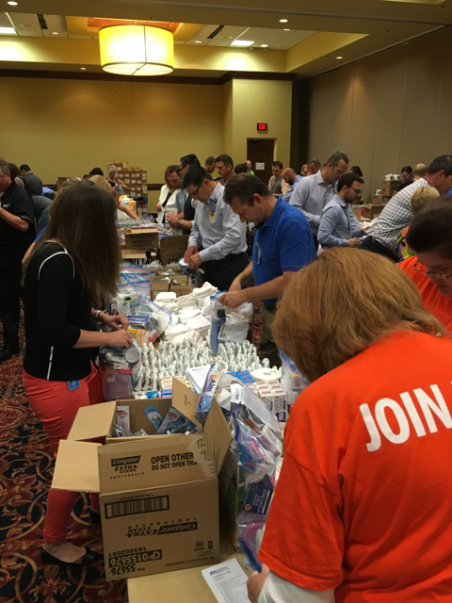 Group of men and women packing international medical corps kits