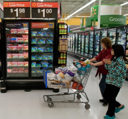 Shoppers fill their baskets at a Walmart Supercenter