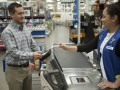 Walmart Cashier helps Customer use new Chip and Pin machine at checkout