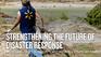 Walmart Associate cleans up fallen trees in Katrina Aftermath