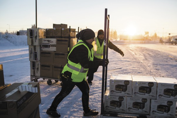 workers unloading toasters in Alaska