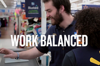 "Walmart store associates work together. Text reads ""WORK BALANCED"""