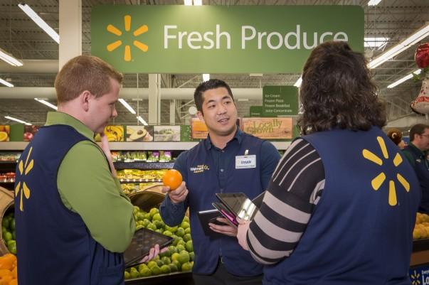 Academies training associates in produce department