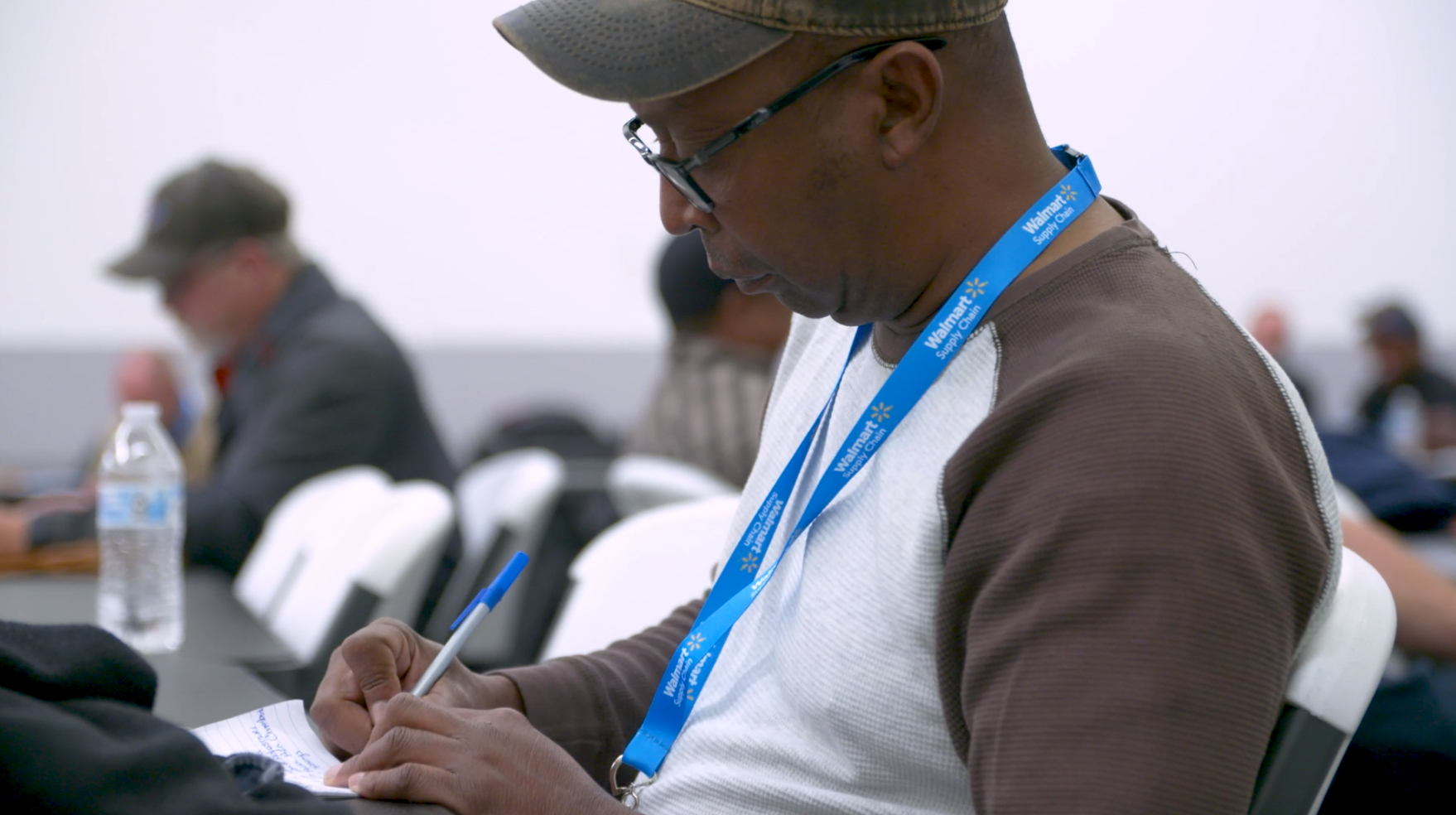 A new Walmart truck driver takes notes at an onboarding event