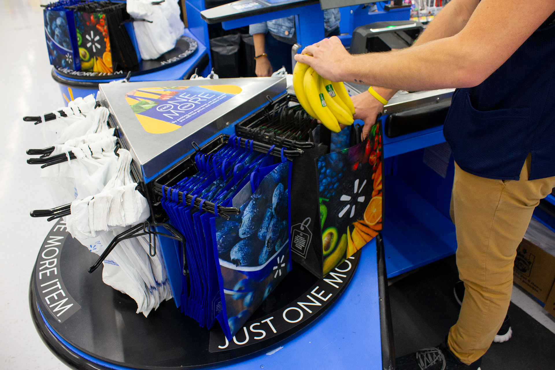 Reusable bag being used by associate