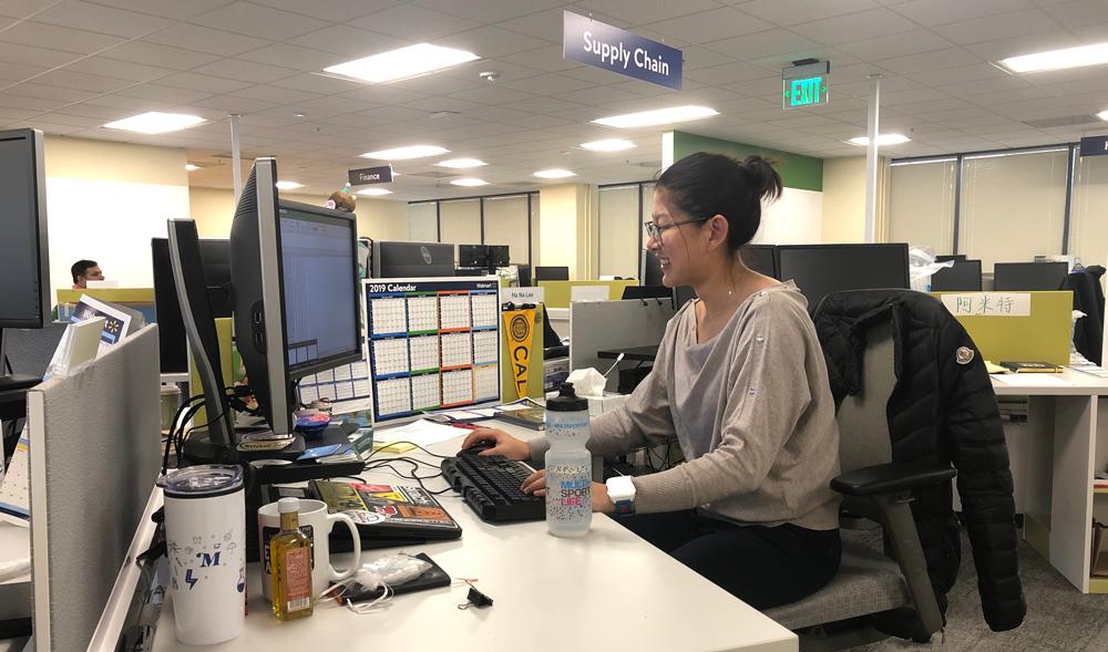Ha Na Lee sits at her desk in Walmart's San Bruno, California office