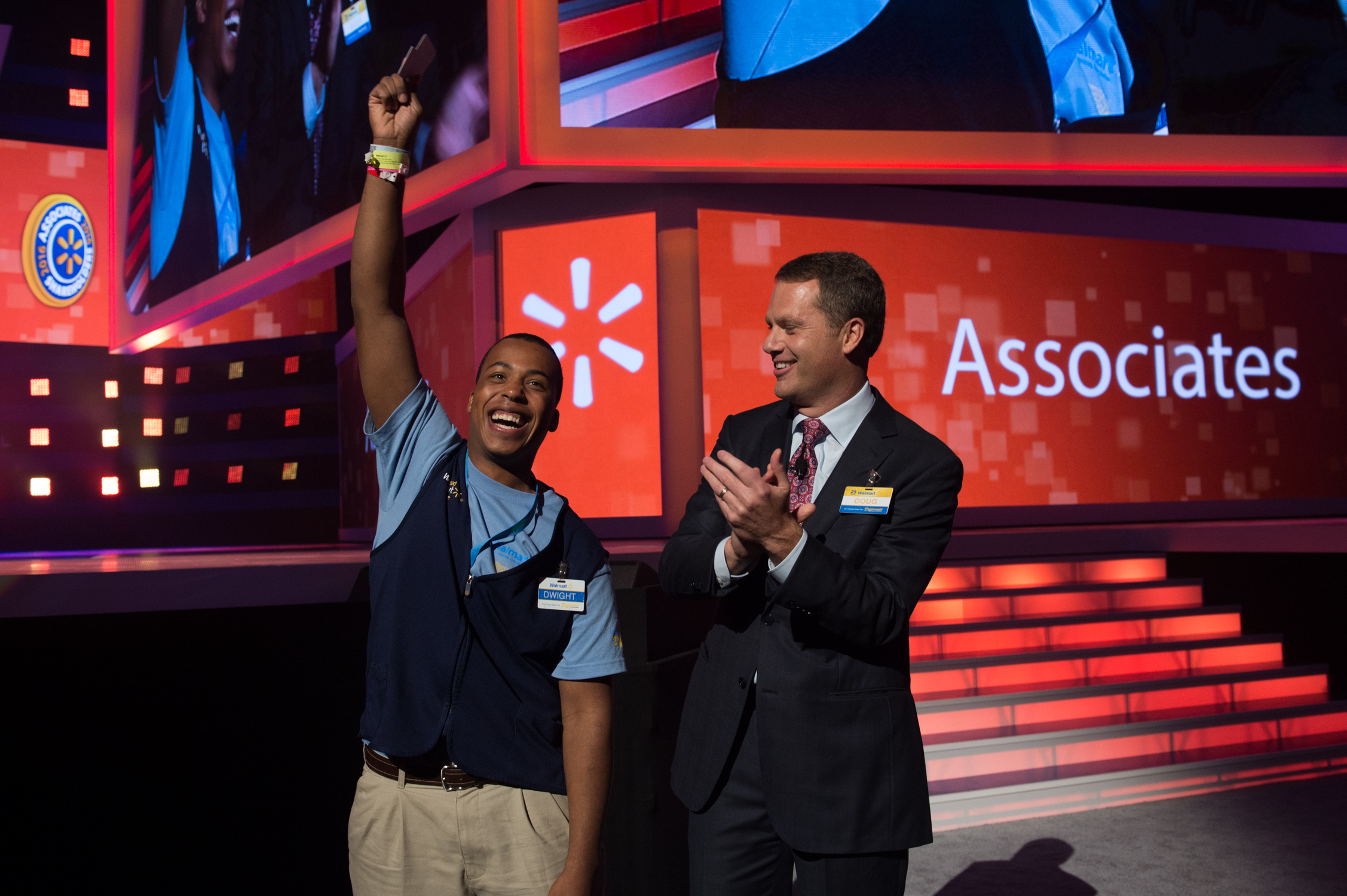 Associate Dwight celebrates being promoted to Assistant Manager by Doug McMillon