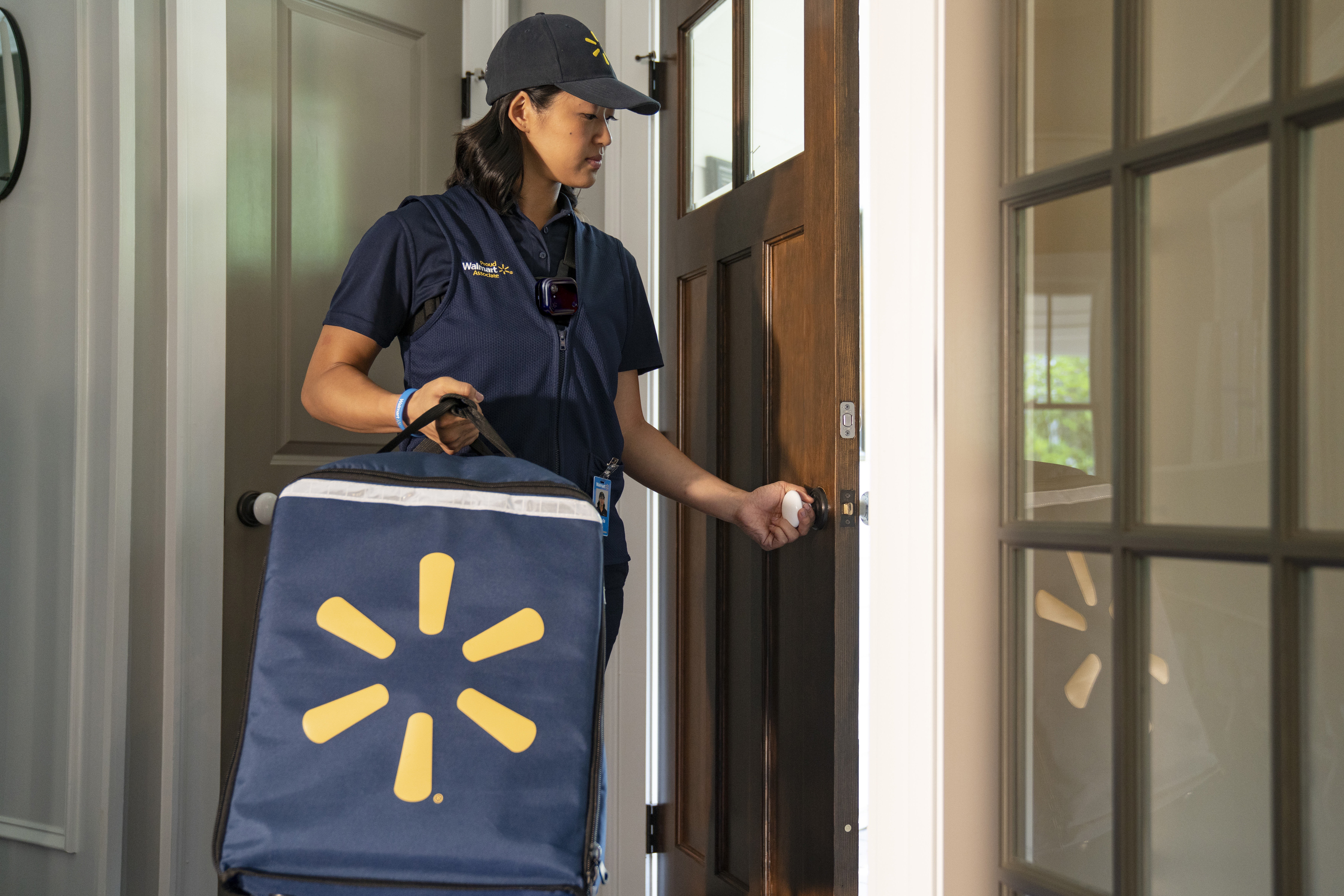Associate entering a home with InHome Delivery