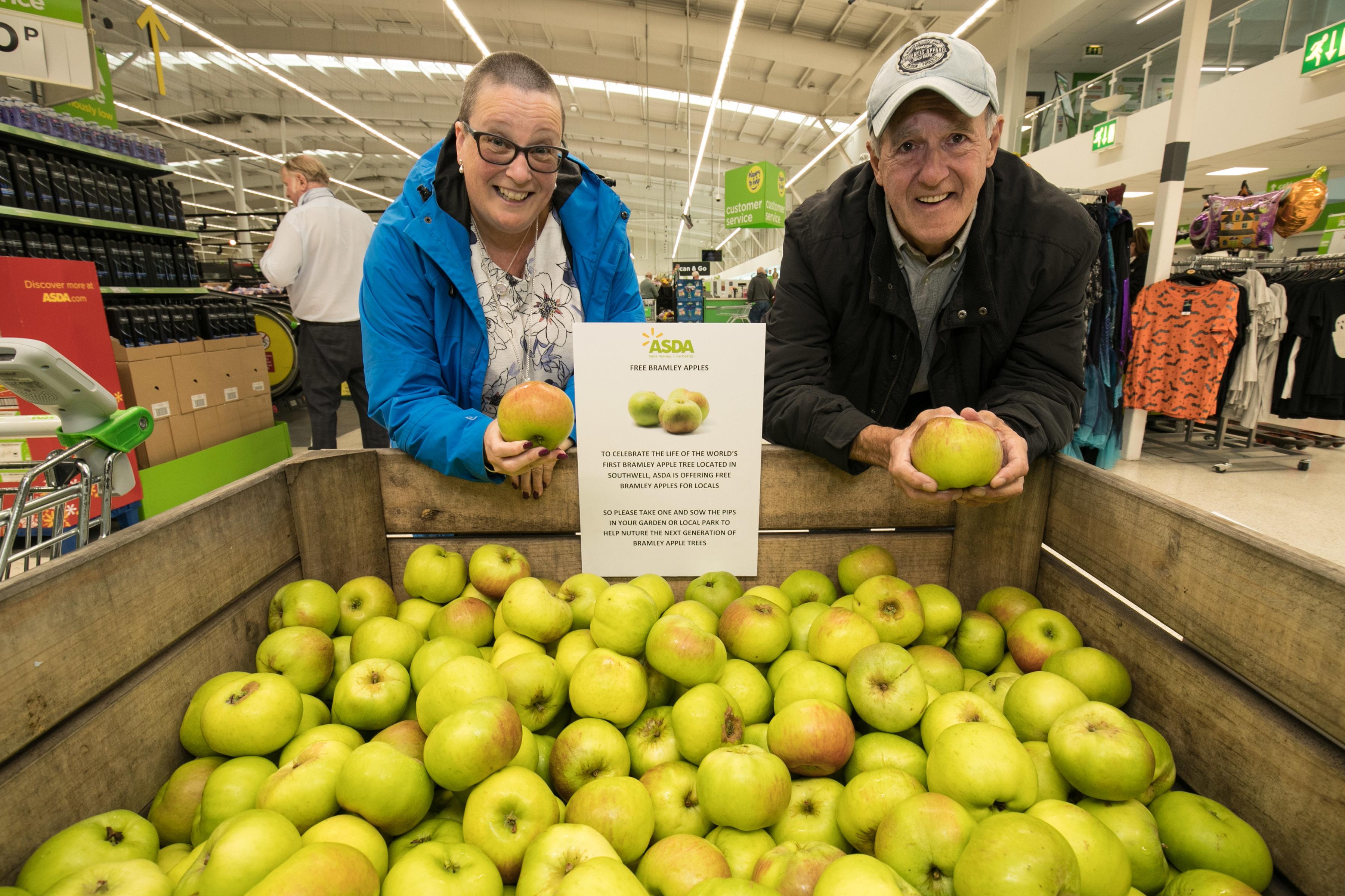 Customers pick up a free apple at Asda West Bridgford