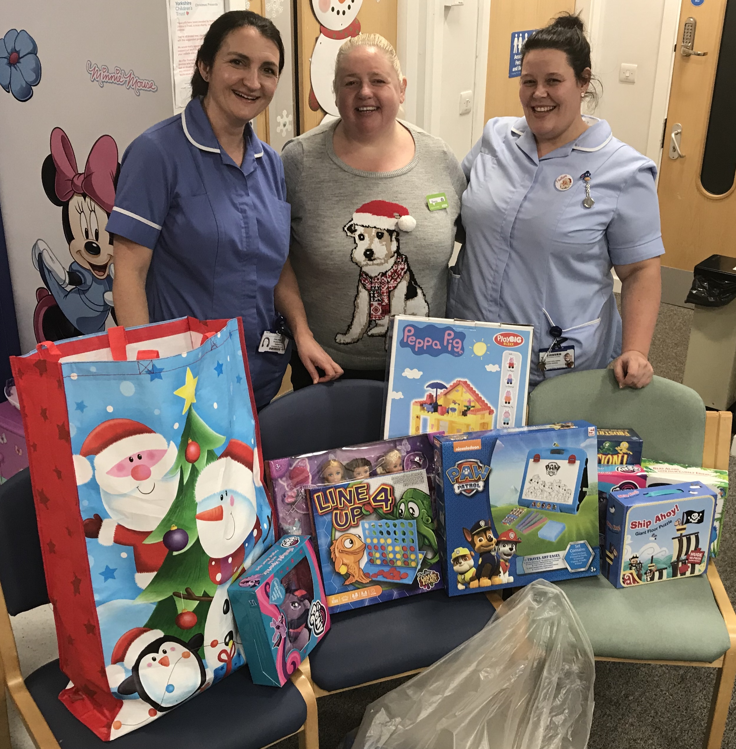 Donating Christmas Gifts: Dewsbury Colleagues Present Donations And Gifts To Local