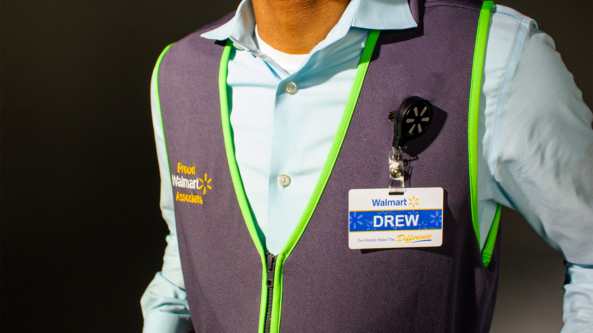 Associate wearing new green vest showing close up