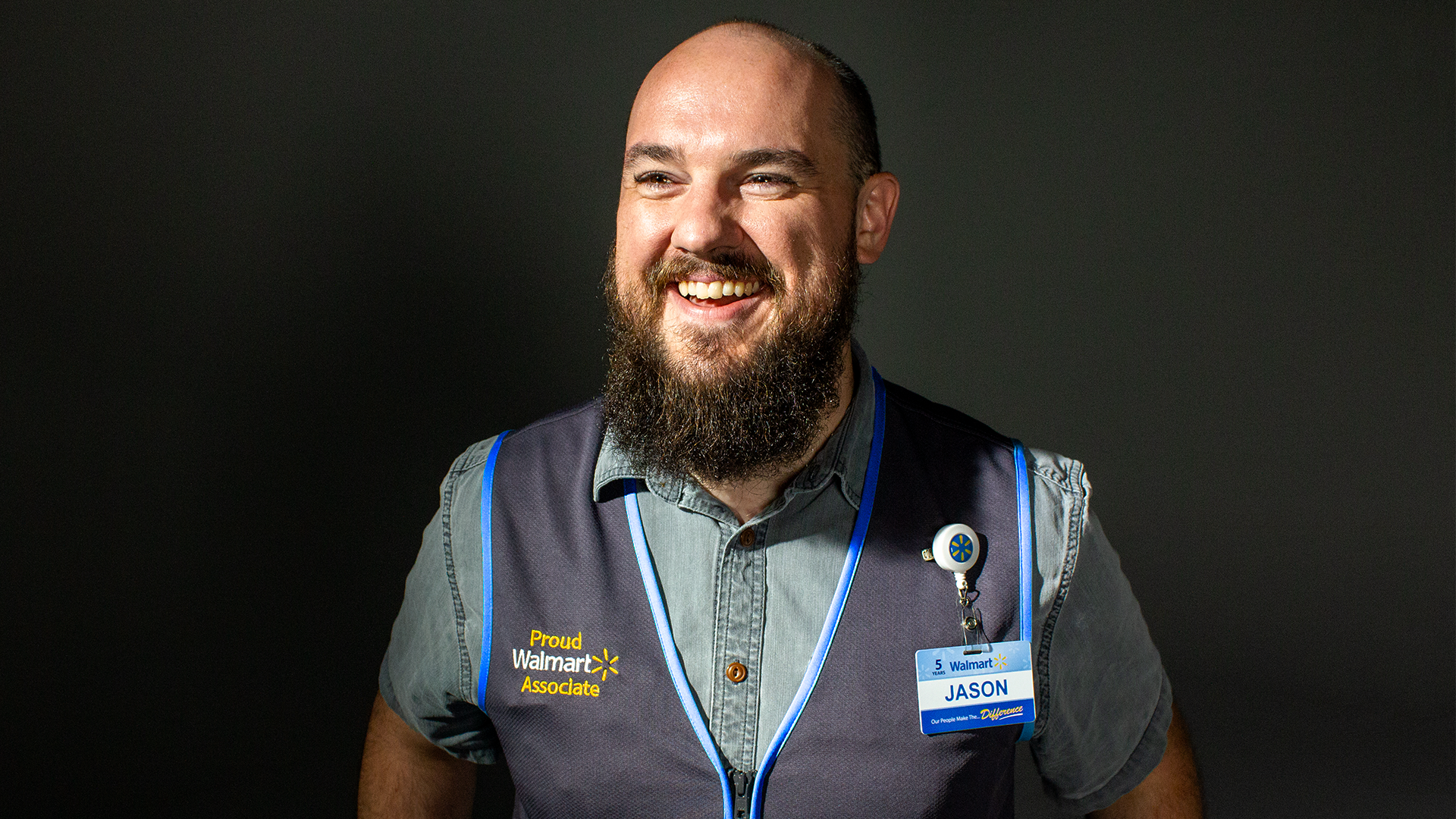 Associate wearing new blue vest showing close up