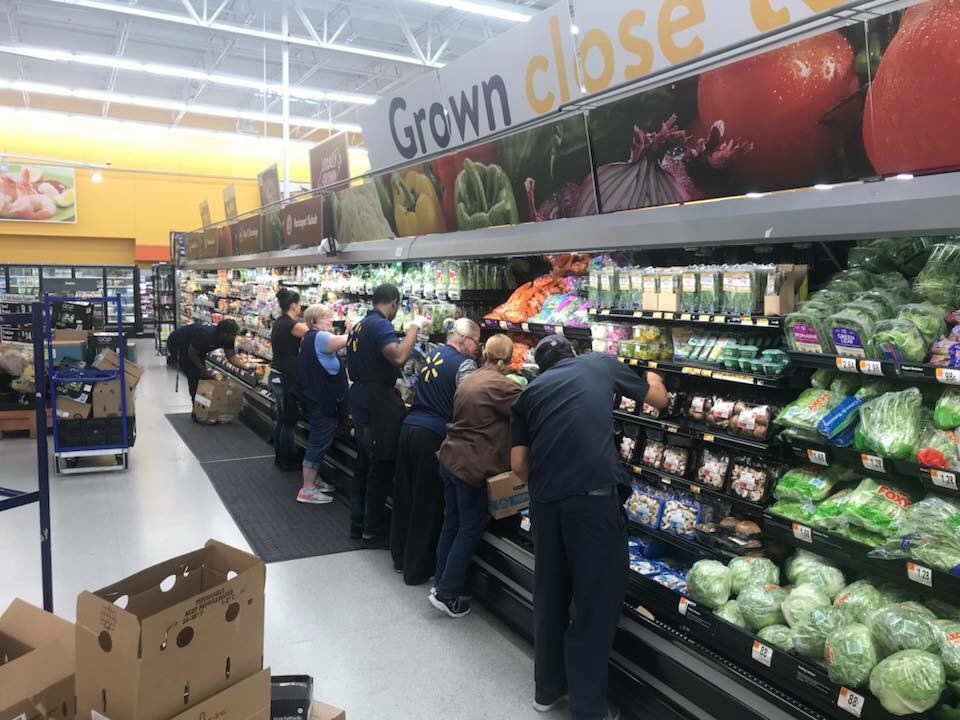 Associates restock produce in Spring Lake, NC after Hurricane Florence