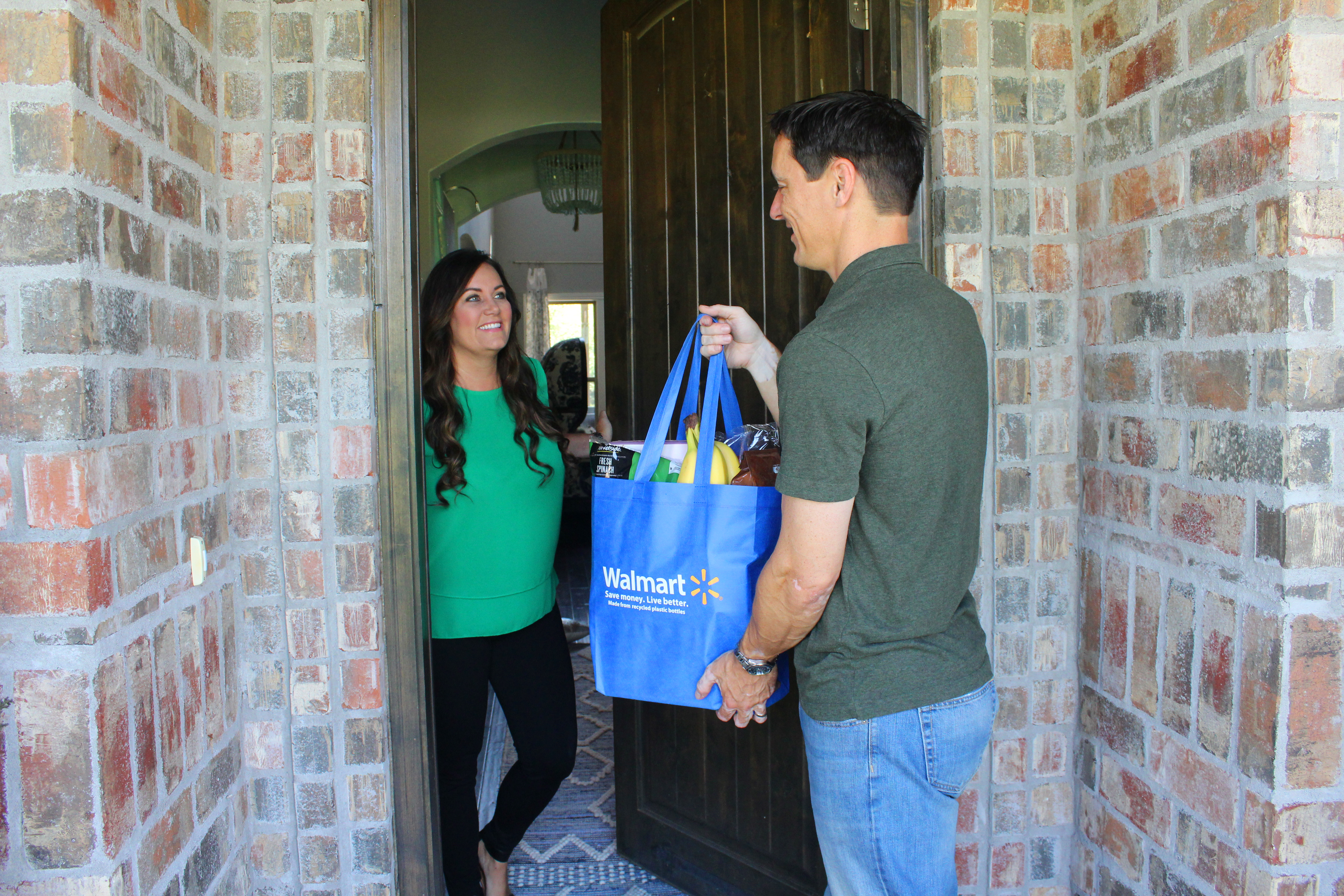 A driver delivers a Walmart Grocery Delivery order
