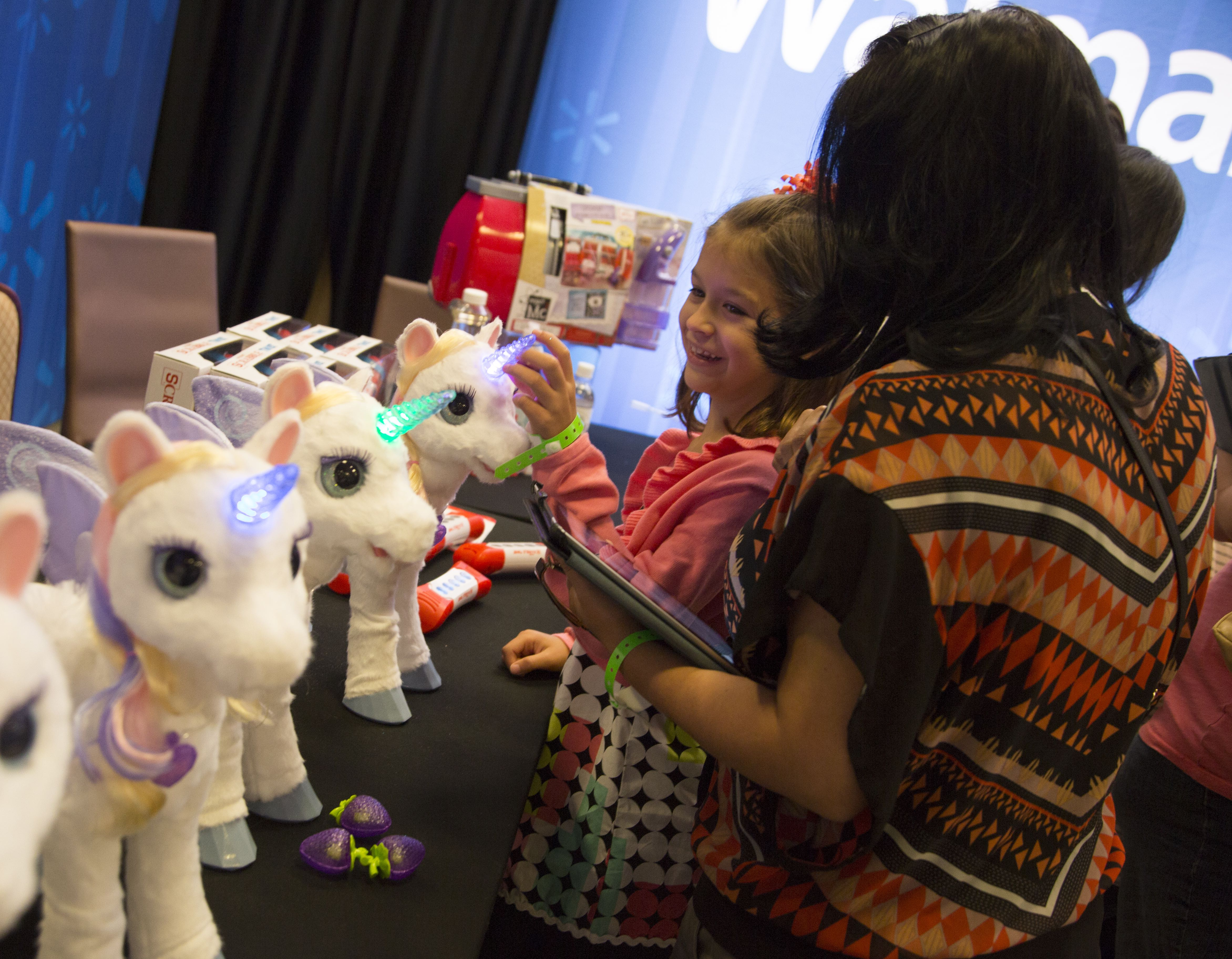 Walmart Toys For Girls : A young girl plays with the furreal unicorn toy