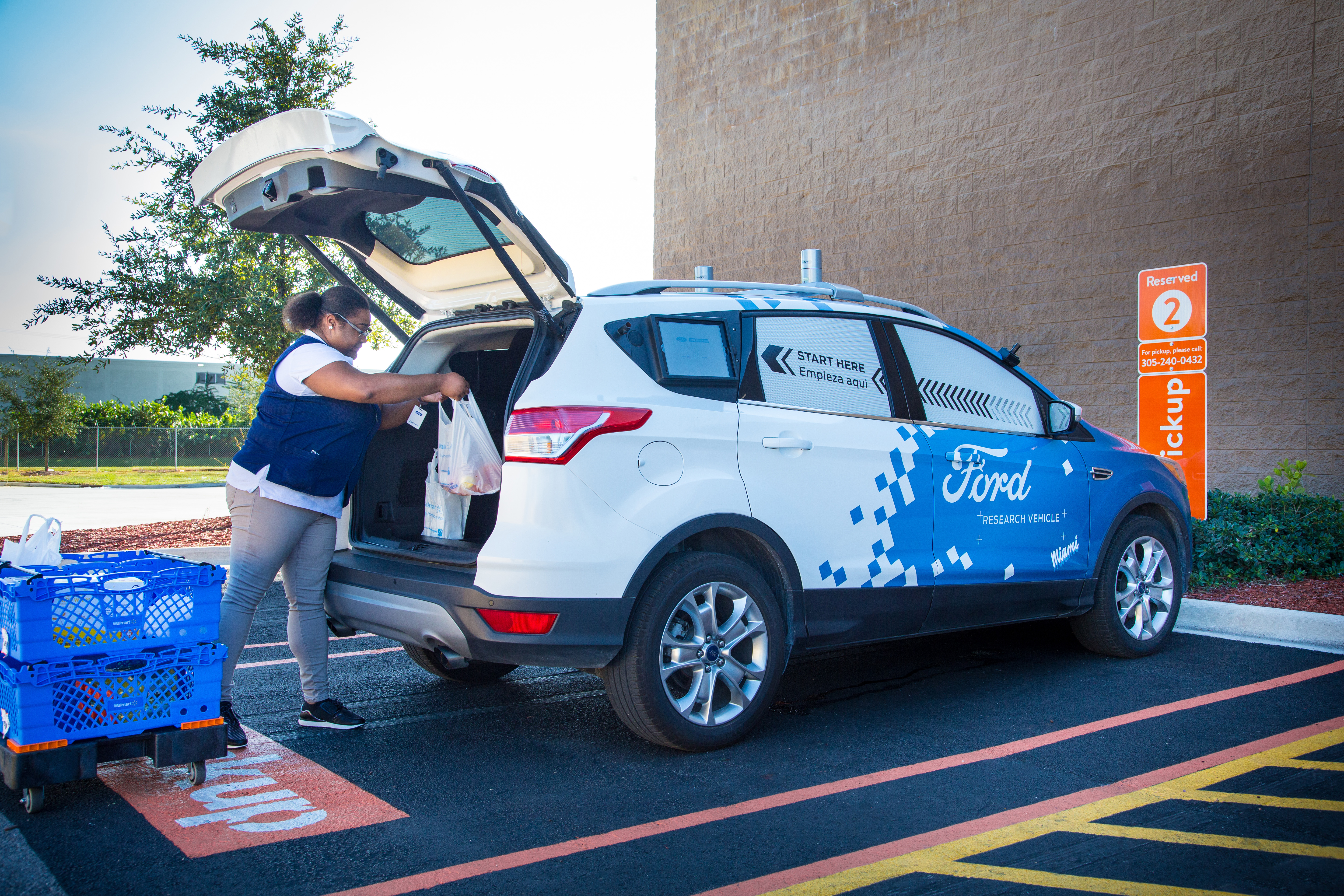 Walmart Car Shop Tire, A Walmart Associate Places A Grocery Delivery Order In A Ford Self Driving Vehicle, Walmart Car Shop Tire