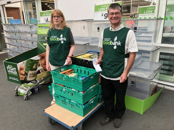 Volunteer Alice Hedge with Leeds & NW foodbank Warehouse manager Clifford Parker