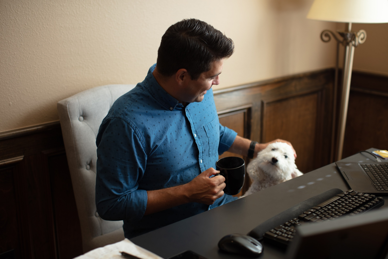 Walmart emergency management associate, Joe Pennington, pets his dog