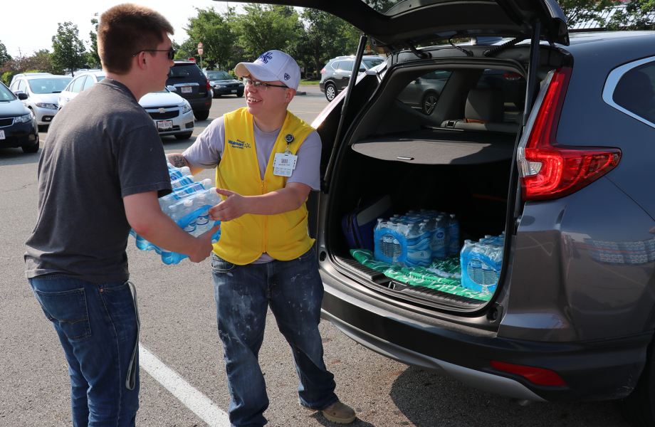 Associate helping with disaster relief by delivering water