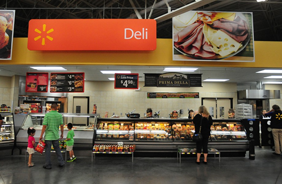 Shoppers scan the offerings at the Walmart Deli counter