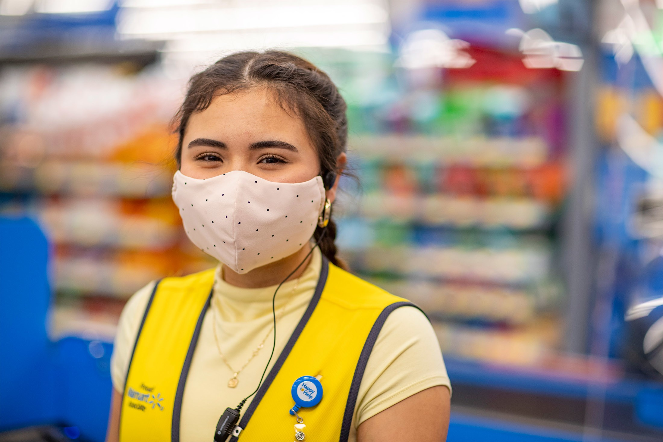 Associate Smiling in Yellow Vest Wearing a Mask
