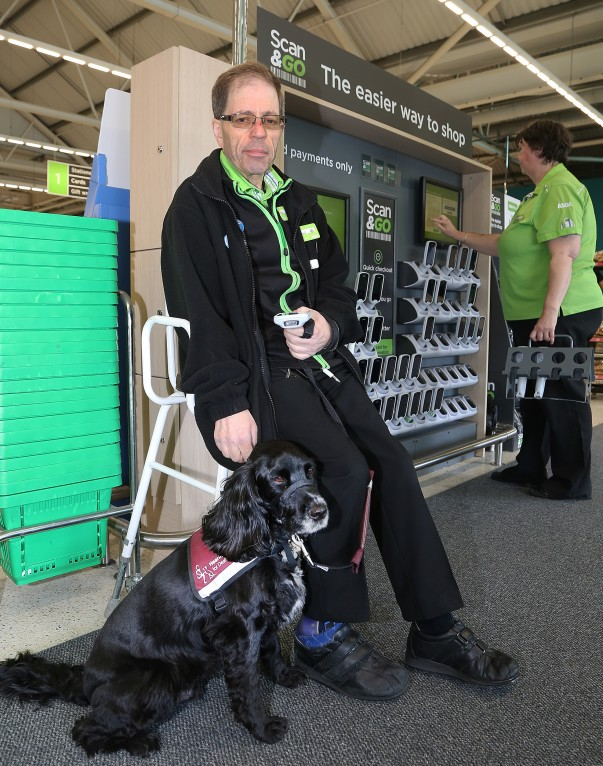 Asda Biggleswade colleague Russell with his hearing dog Ben