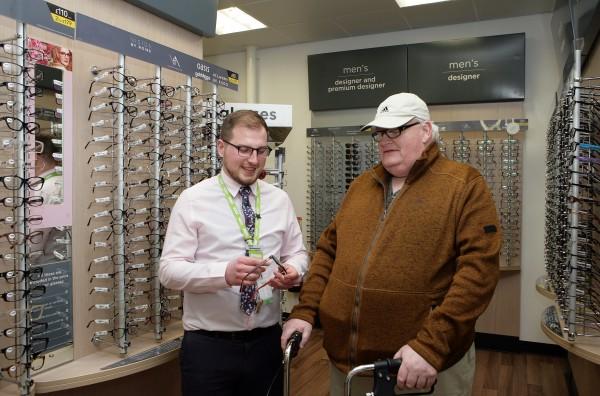 Asda Enniskillen optician Ross Hennessey with customer Billy Irwin