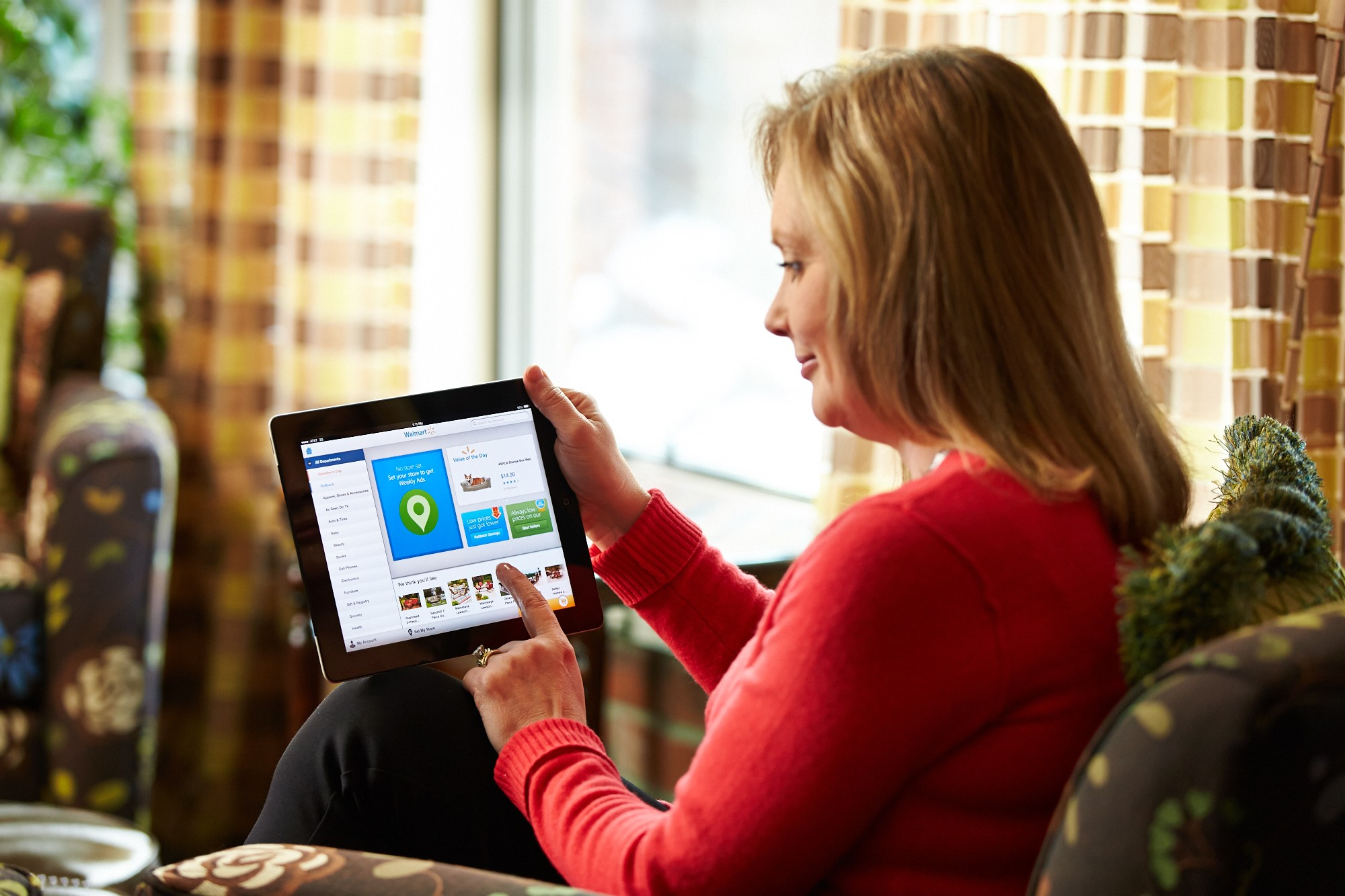 A female customer shops Walmart.com from tablet